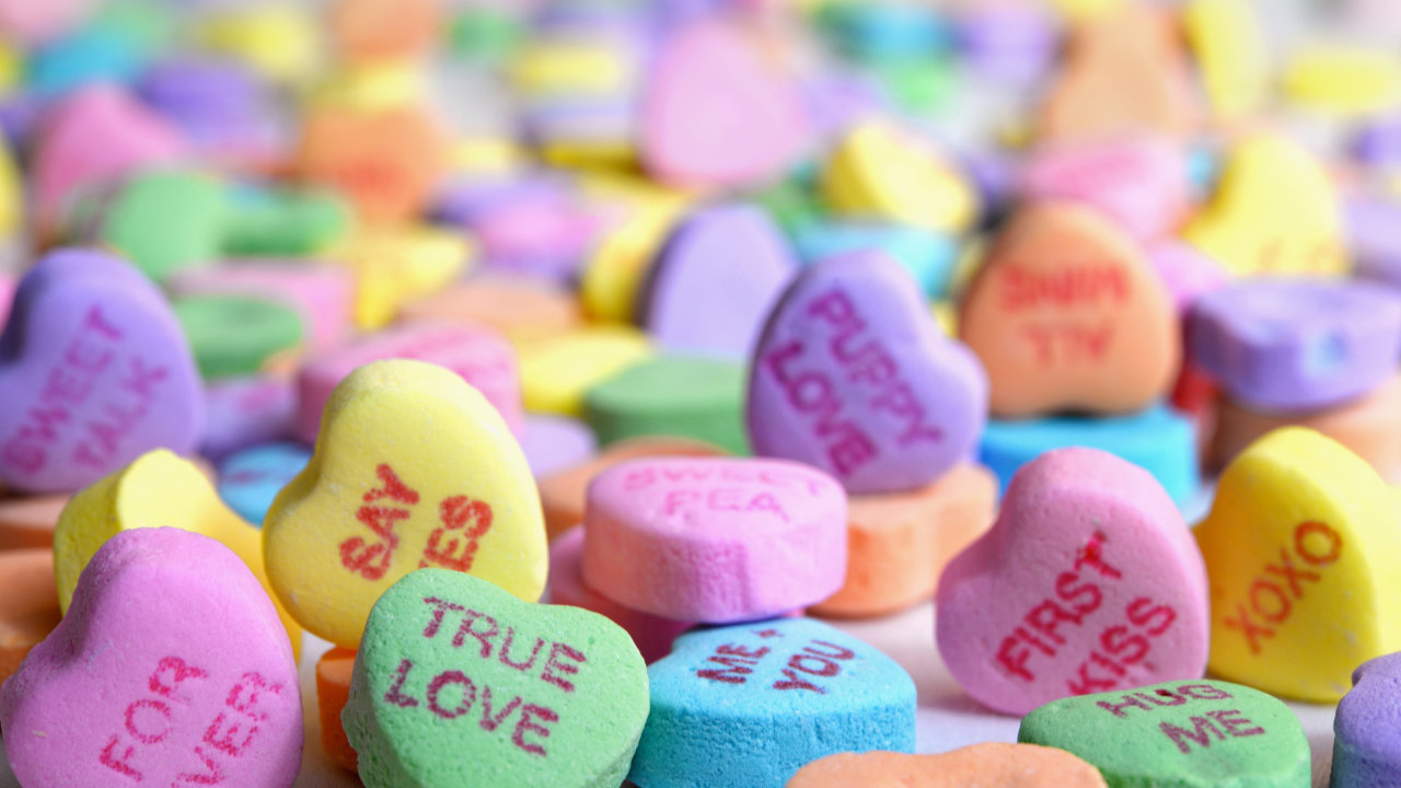 A large spread of candy hearts.
