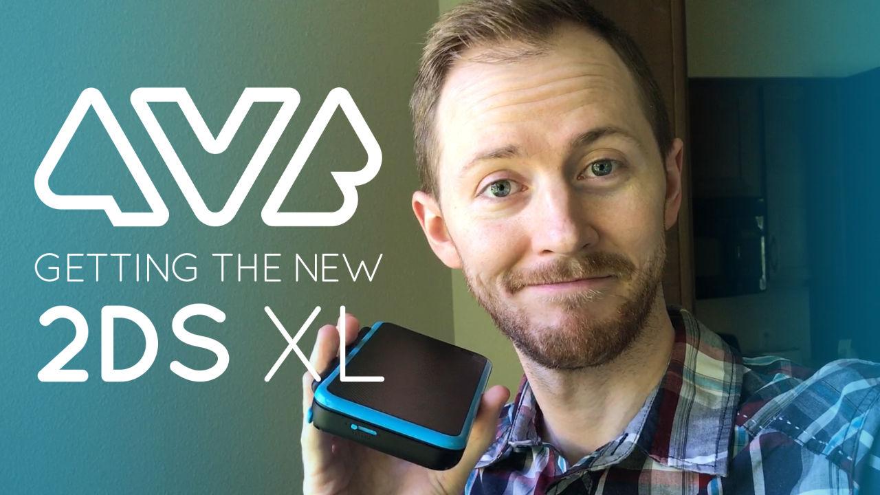 Jon holding a Nintendo 2DS XL