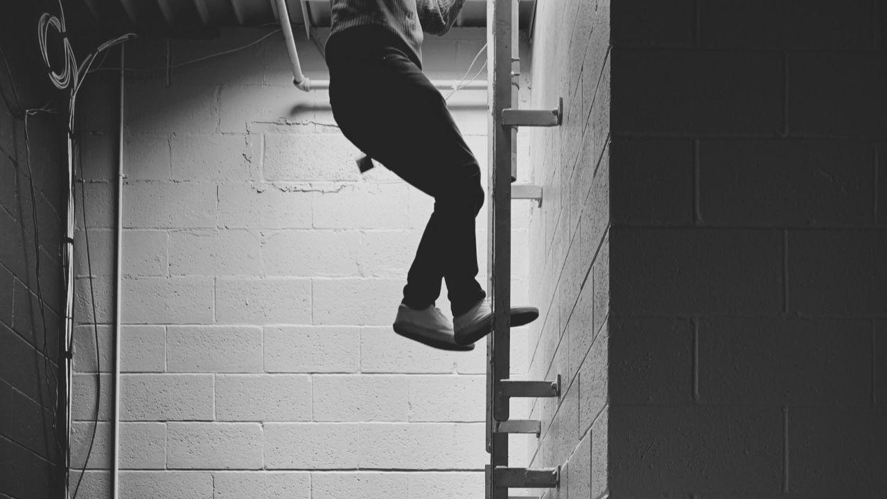 Descending a ladder.