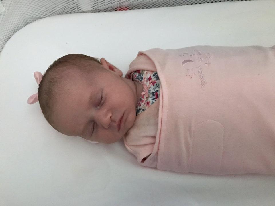 Olivia swaddled and sleeping.